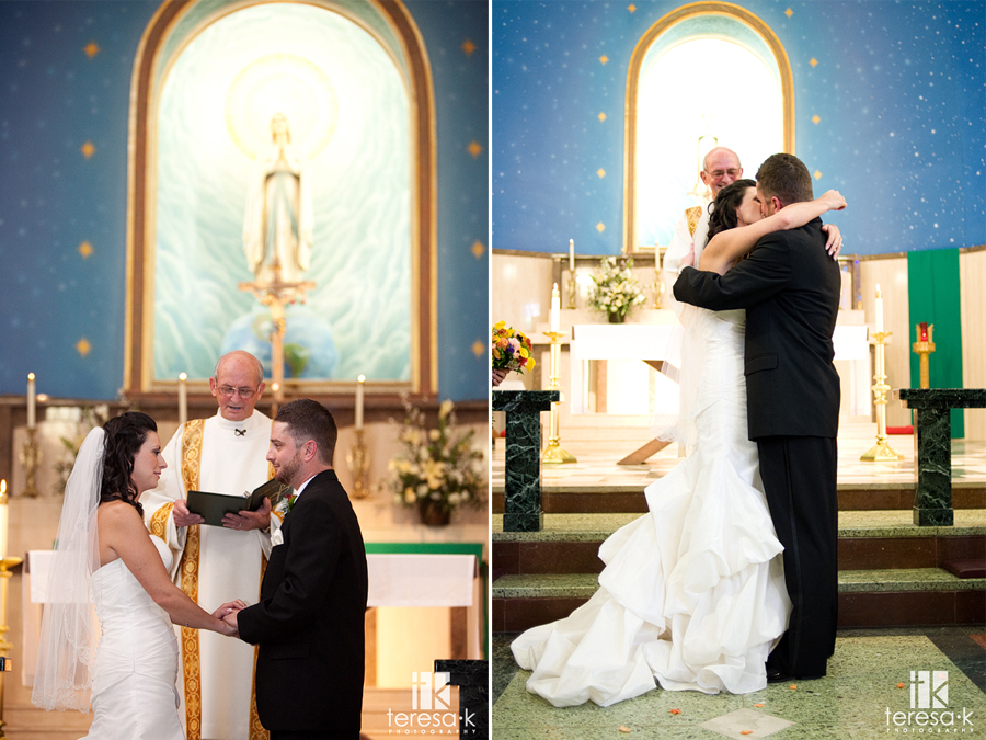 First kiss at St. Mary's church in Sacramento, California by Sacramento wedding photographer Teresa K