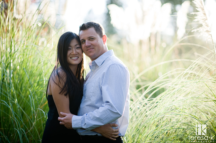 gorgeous backlit image in the foothills of northern California of newly engaged couple