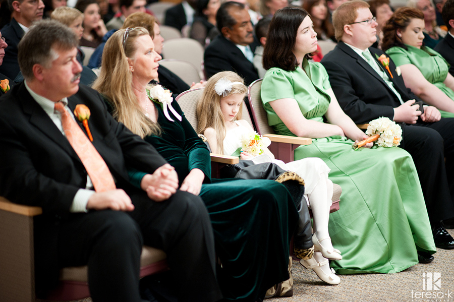 flower girl falling asleep at wedding ceremony
