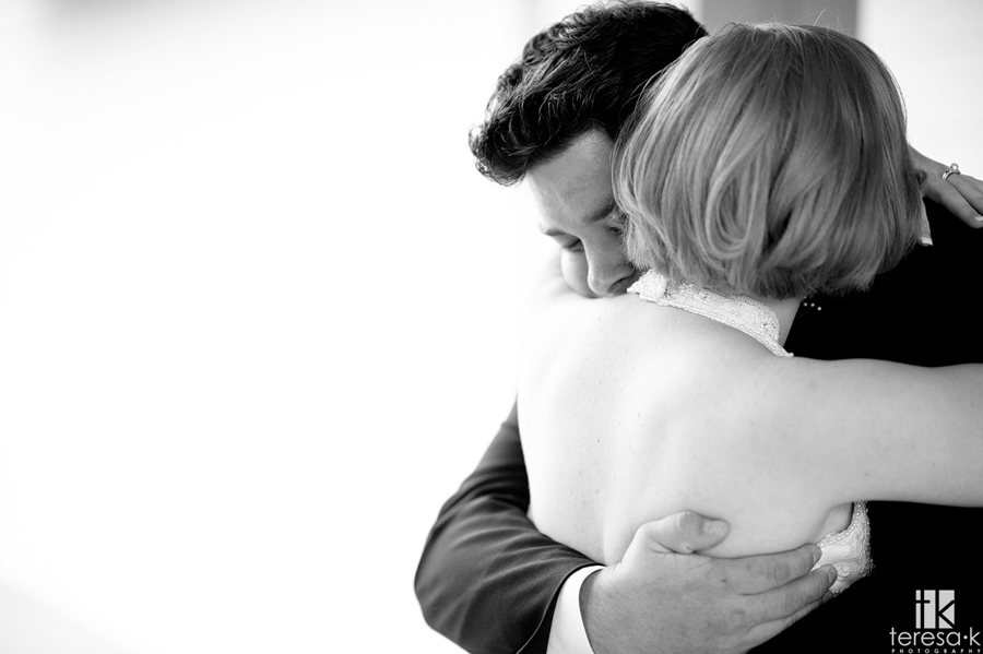 bride and groom in an emotional embrace
