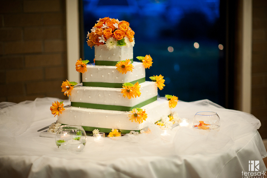 orange and green accented wedding cake