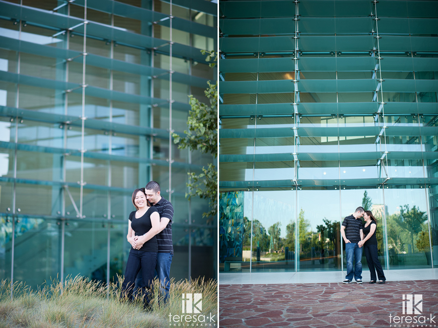 modern engaged couple in front of the CalStrs building