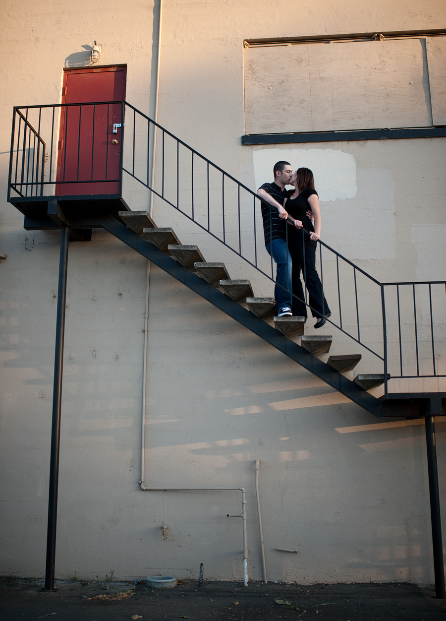 modern urban image of bride and groom on staircase