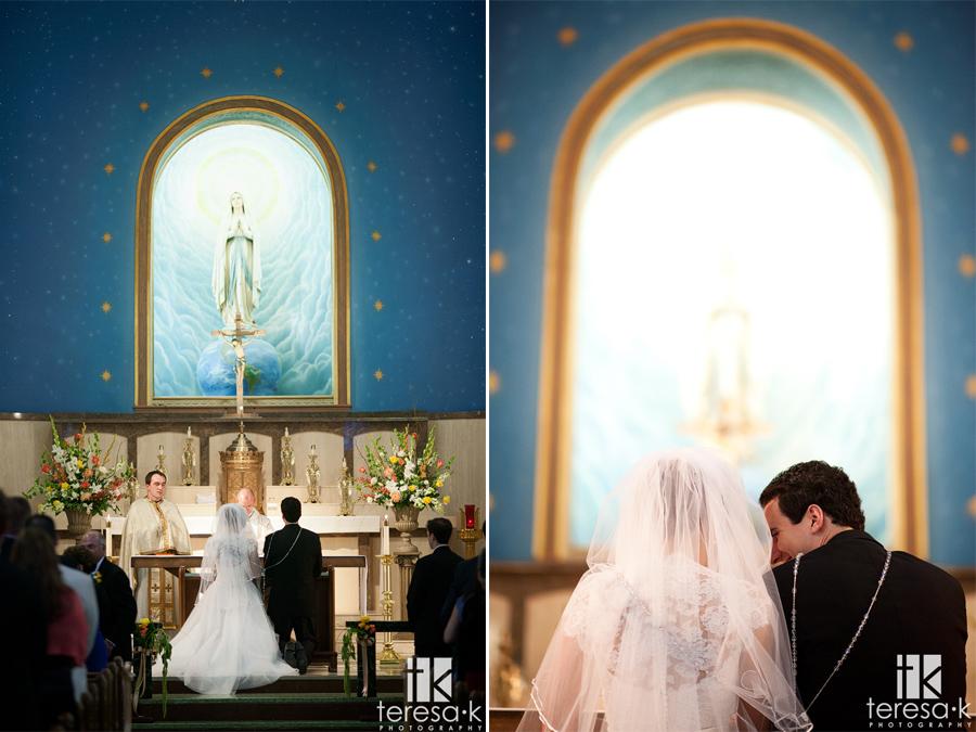 groom sneaks a peek at bride in catholic ceremony