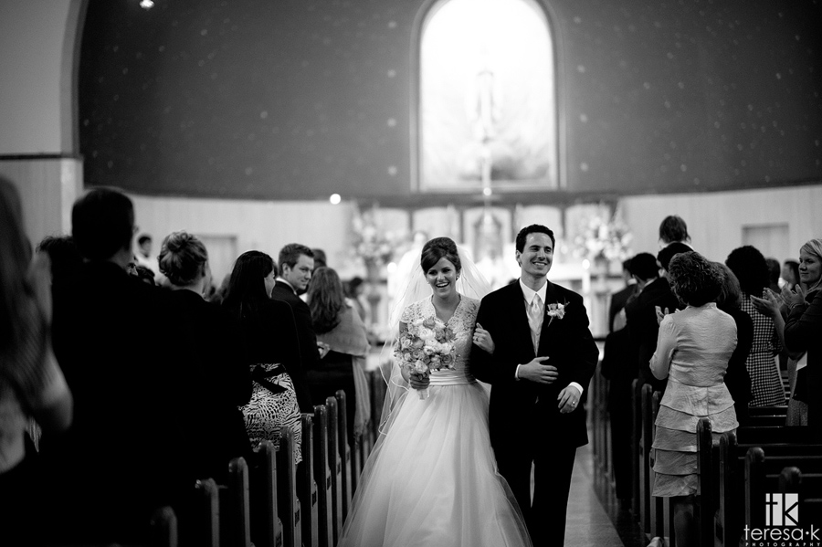man and wife walk down the aisle at st. Mary's church