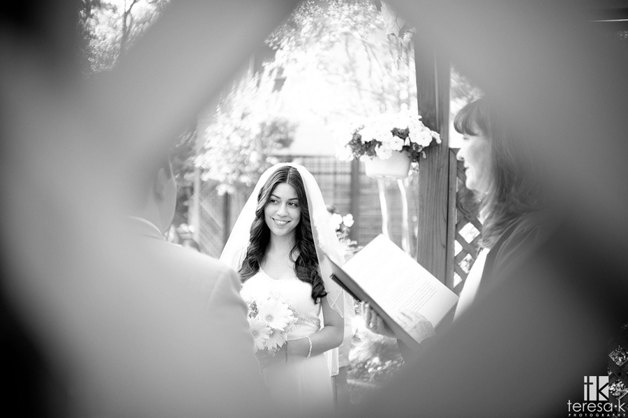 view of bride at outdoor ceremony
