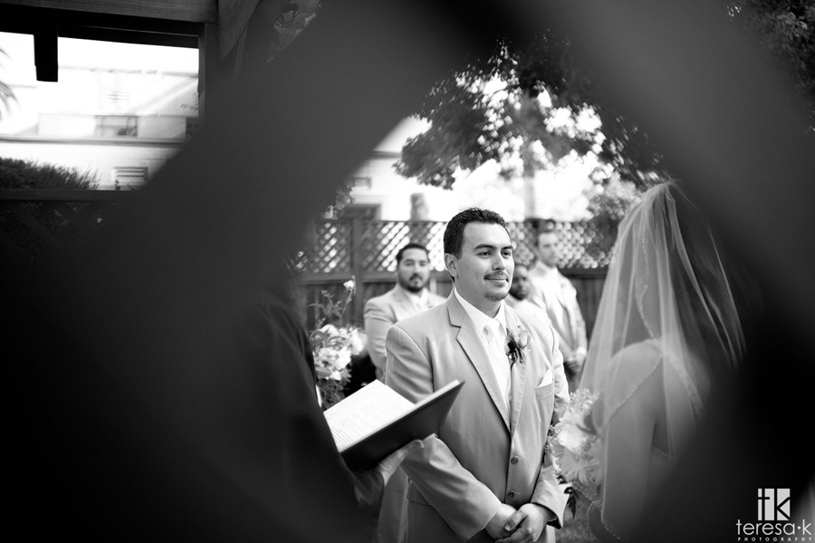 view of groom at outdoor ceremony