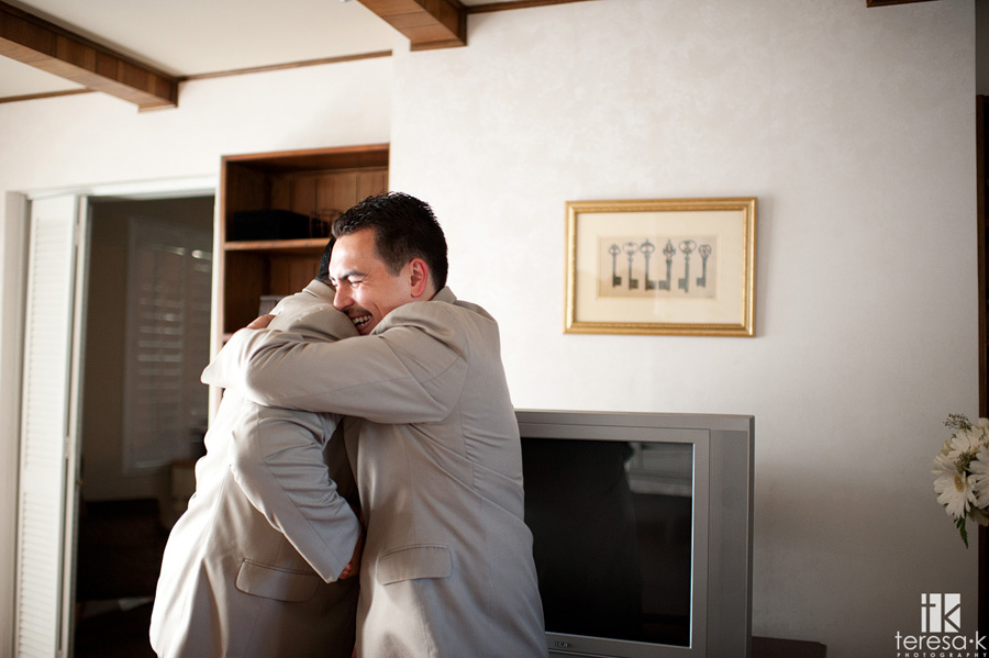 Groom hugging his brother after the wedding ceremony