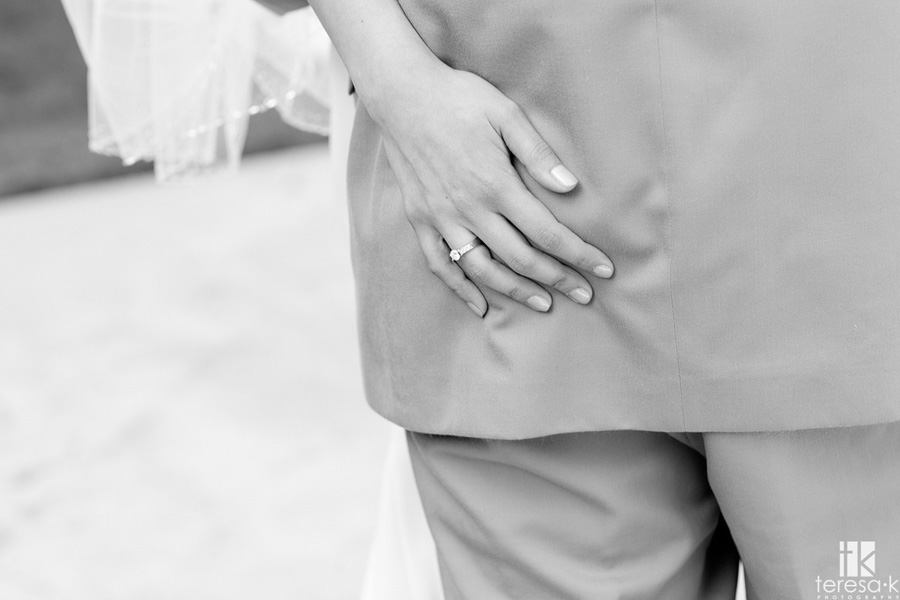 playful picture of bride pinching grooms butt at the Lions Gate Hotel and Conference Center