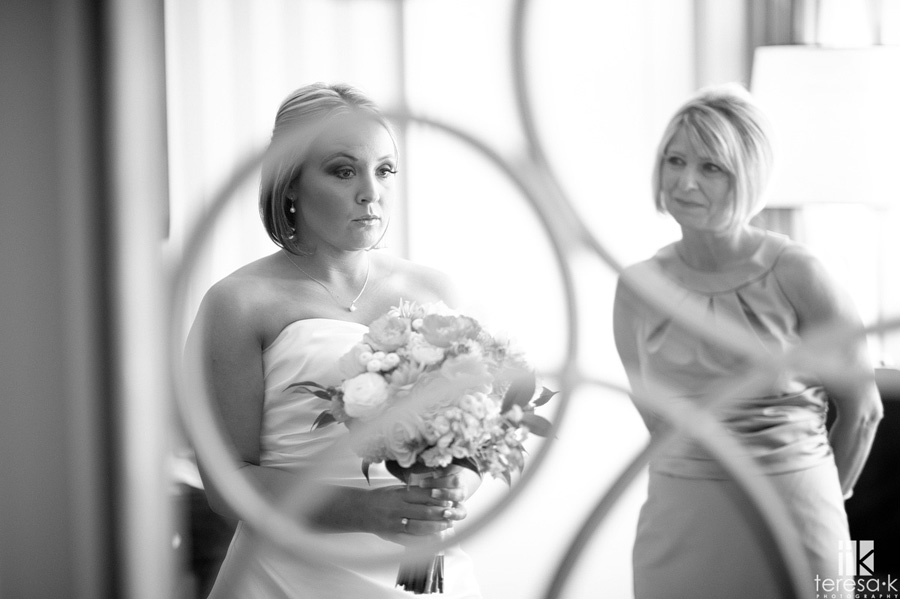 beautiful bride looking in mirror at the citizen hotel