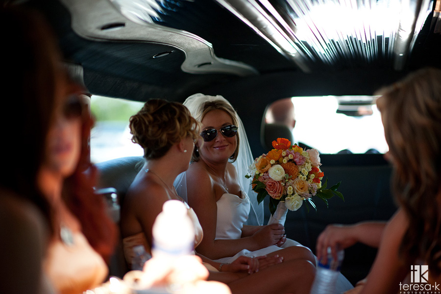 wedding party rides in limo to st Mary's church wedding