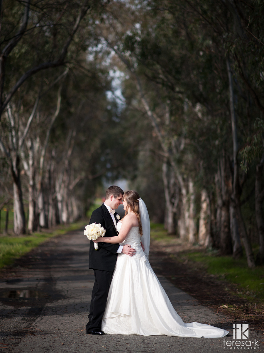 bride and groom on a road