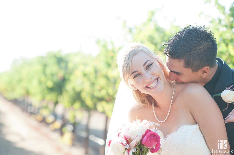 groom nuzzling brides neck