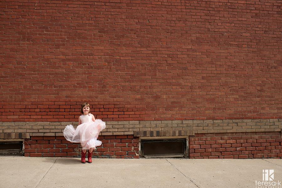 fun little girl in pink skirt