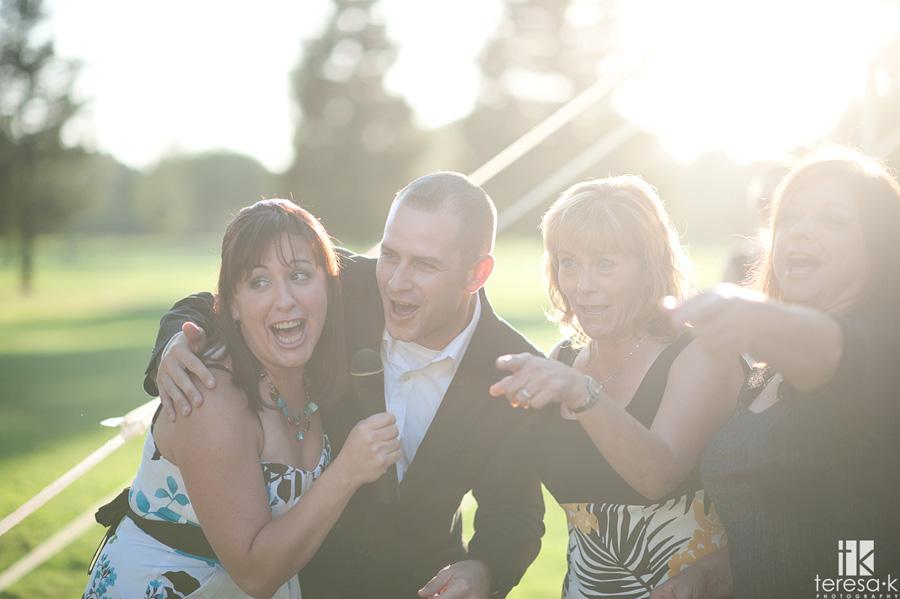 guests serenade bride and groom