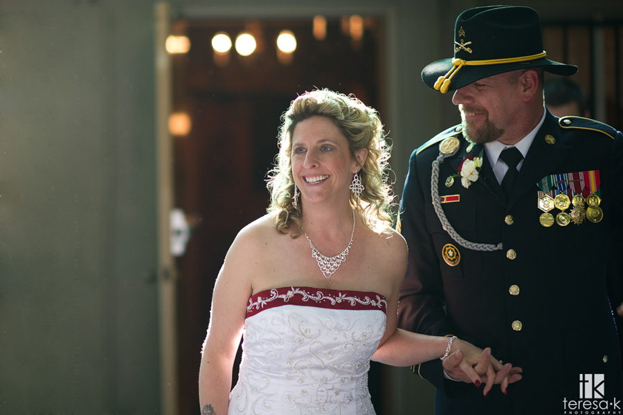 bride and army groom enter reception
