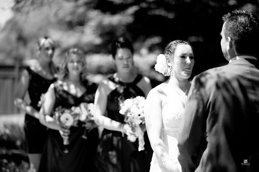 bride sticking tongue out at groom