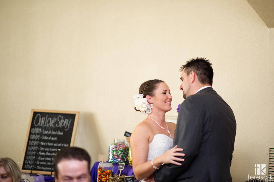 bride and groom steal a kiss at reception