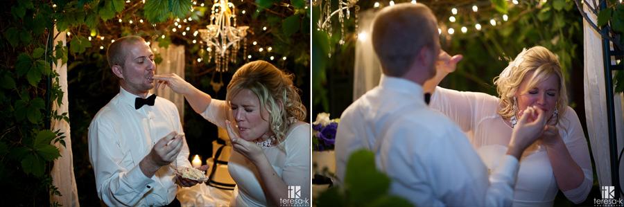 groom shoves cake in brides face