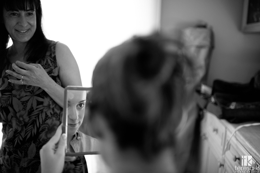 bride looking at reflection in mirror