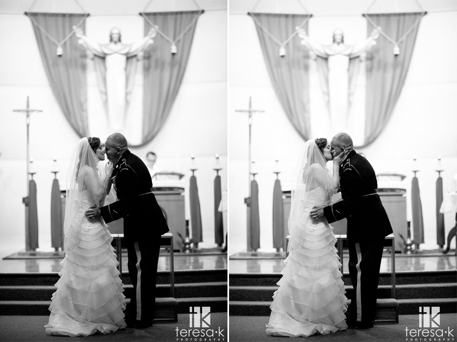 bride and groom kiss on the alter