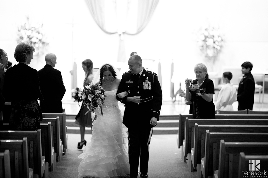 bride and groom in Folsom catholic church