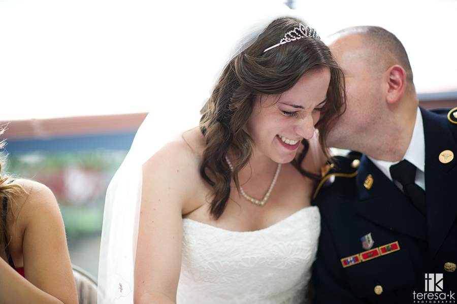 groom whispers a secret in brides ear