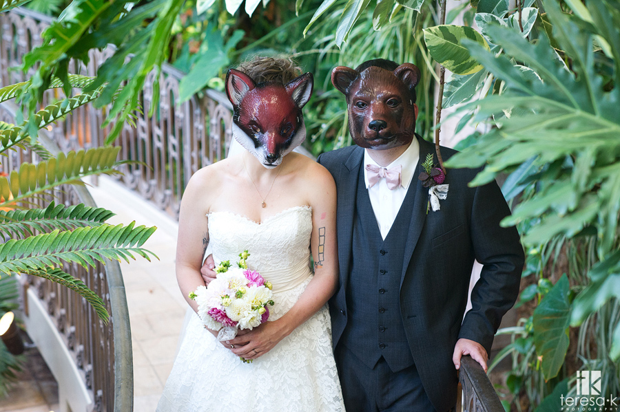 bride and groom in zoo masks