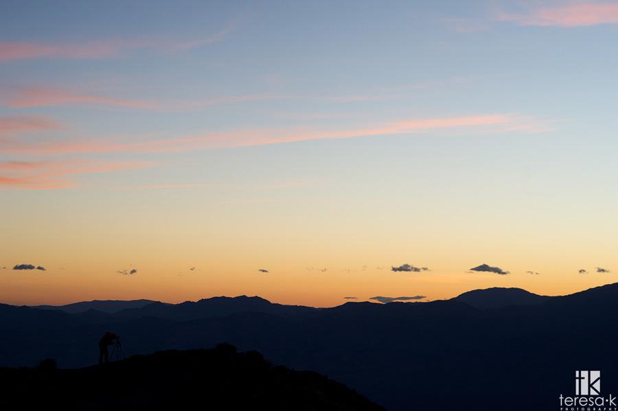 photographer at dantes peak in sunset