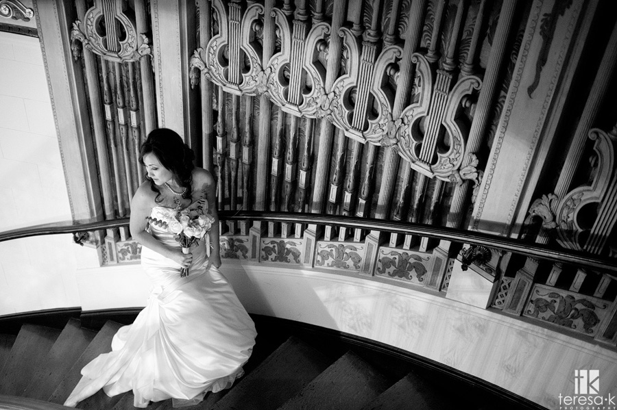 bride on the staircase at the grand island mansion