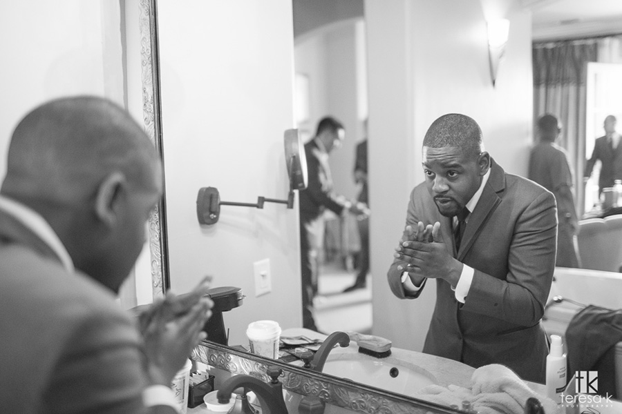 groom grooming himself for wedding