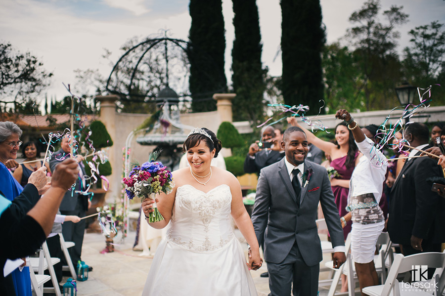 bride and groom recessional in the villa at arden hills