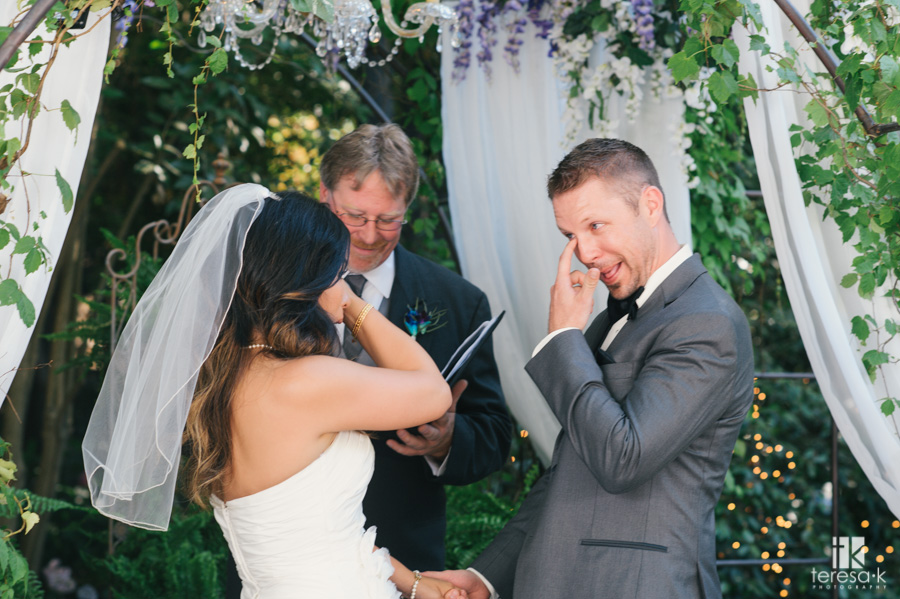 bride and groom wipe tears at same time